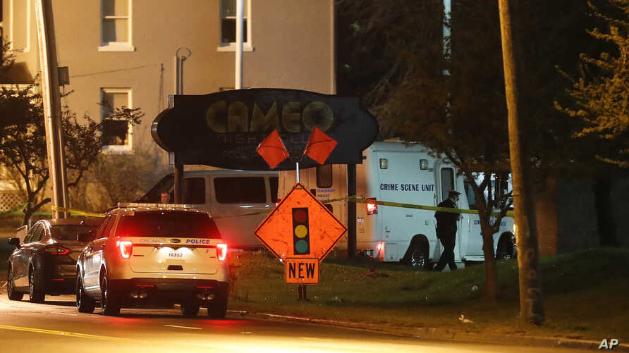 Police operate at a crime scene outside the Cameo Nightclub after a reported fatal shooting, Sunday, March 26, 2017, in Cincinnati. At least two people opened fire inside a crowded nightclub early Sunday morning.