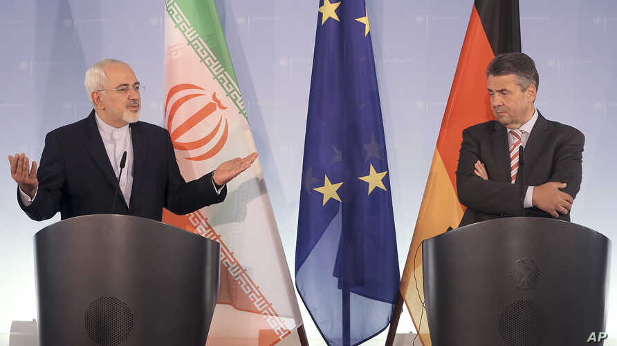 Iran's Foreign Minister Mohammad Javad Zarif, left, and his German counterpart, Sigmar Gabriel, attend a news conference at the Foreign Affair's Office in Berlin, Germany, June 27, 2017.