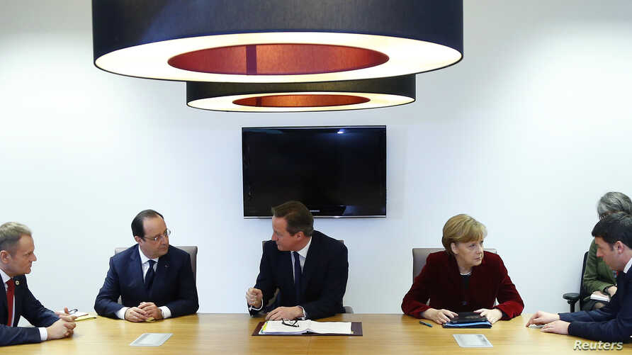 Poland's Prime Minister Donald Tusk (L-R), France's President Francois Hollande, Britain's Prime Minister David Cameron, Germany's Chancellor Angela Merkel and Italy's Prime Minister Matteo Renzi meet ahead of a European leaders emergency summit on U