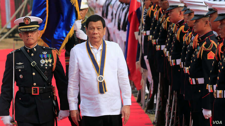 Philippine President Rodrigo Duterte reviews honor guards upon his arrival during the Philippine Navy's 120th anniversary in Metro Manila, Philippines, May 22, 2018.