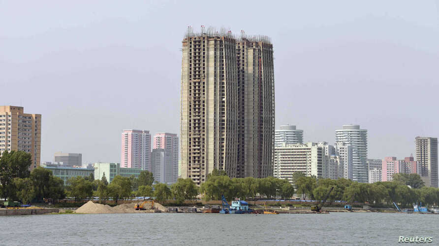 FILE - View from the Taedong River of the construction of apartment buildings for faculty members of Kim Ch'aek University of Technology in this undated photo released by North Korea's Korean Central News Agency (KCNA) in Pyongyang, May 21, 2014.