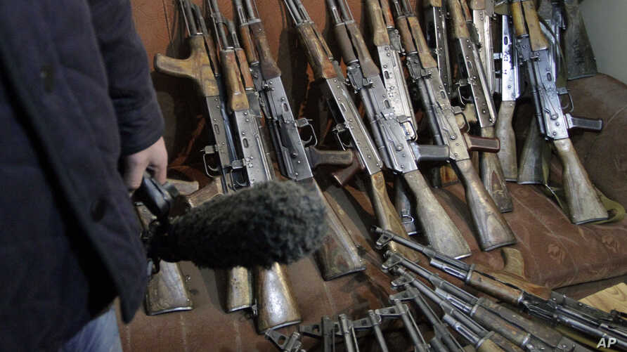 The arms, which were confiscated from the Garda World private security company are shown to media in Kabul, Afghanistan, January 5, 2012.