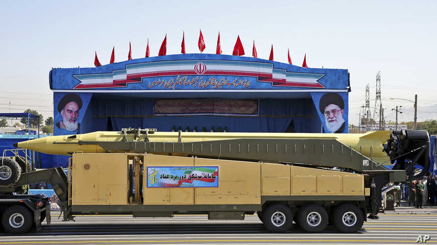 FILE - In this Sept. 21, 2016 file photo, an Emad long-range ballistic surface-to-surface missile is displayed by the Revolutionary Guard during a military parade, in front of the shrine of late revolutionary founder Ayatollah Khomeini, just outside ...
