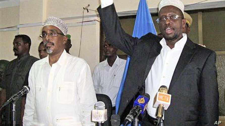 Somalia president Sharif Sheik Ahmed, right, speaks, during the first session in parliament since he named the new prime minister, Mohamed Abdullahi Mohamed. Speaker of Parliament Sherif Hassan Sheik Adan, is at left, in Parliament hall, Mogadishu, S