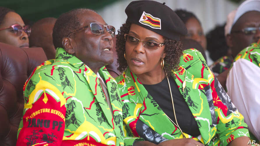 Zimbabwean President Robert Mugabe and his wife Grace follow proceedings during a youth rally in Marondera about 100 kilometers east of Harare, June, 2, 2017.