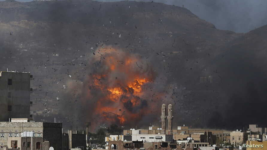 An air strike hits a military site controlled by the Houthi group in Yemen's capital Sanaa, May 12, 2015.