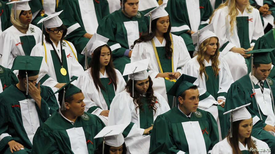 FILE- Reynolds High School students at their graduation ceremony. The Civil Rights Project at UCLA says persistent segregation is worst in northern and western states.