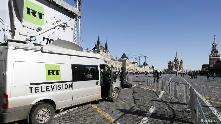 Vehicles of Russian state-controlled broadcaster Russia Today (RT) are seen at Red Square in central Moscow, Russia, March 18, 2018.