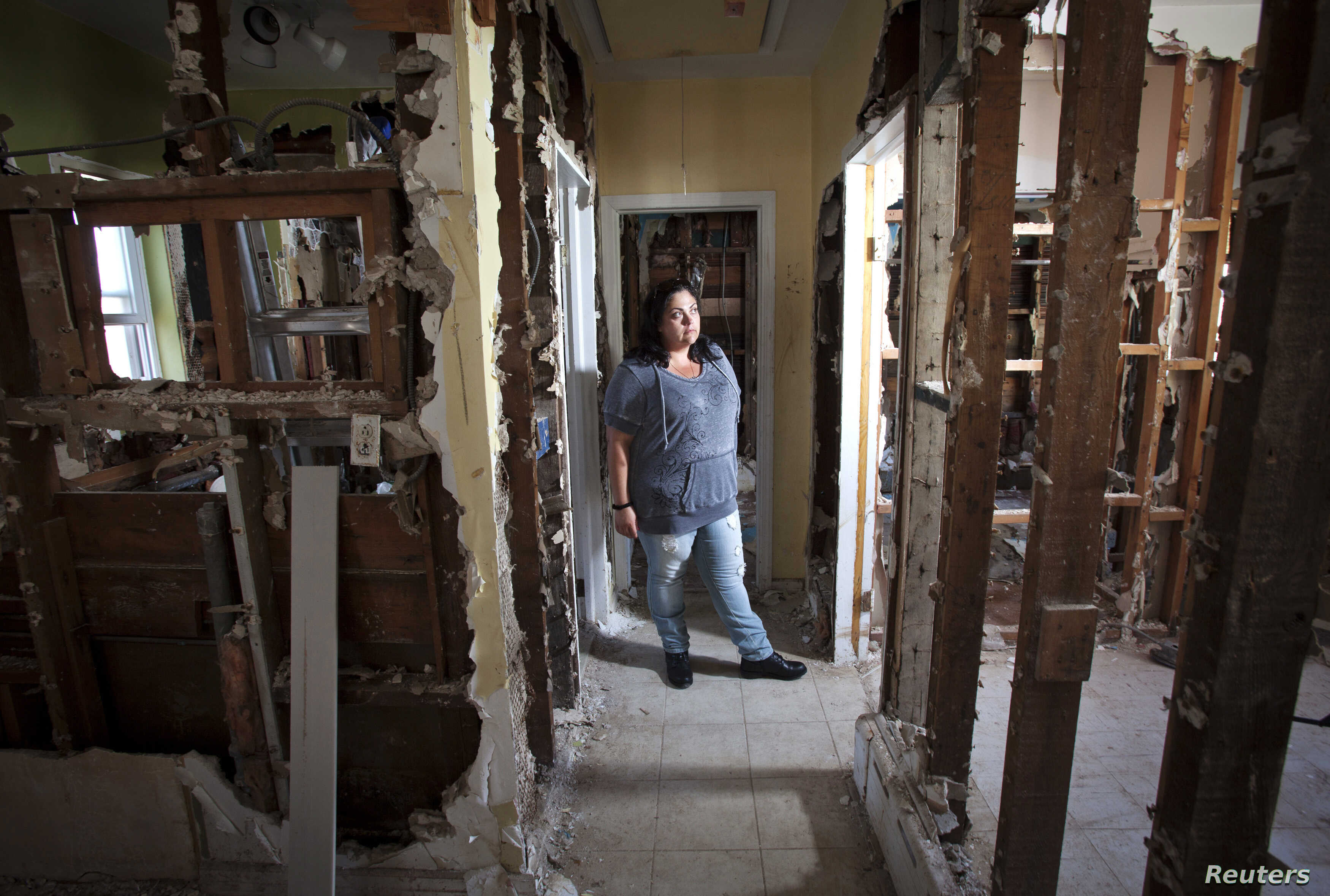 Nicole Chati is in what is left of her home after Superstorm Sandy in the Staten Island borough of New York, Sept. 20, 2013.