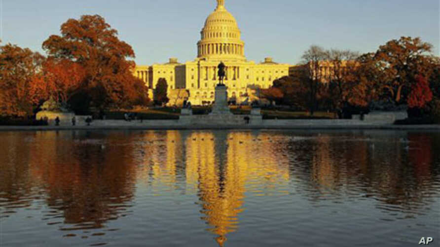The US Capitol reflects the setting sun and is seen in the reflecting pool on Capitol Hill in Washington, Nov 2010 (file photo)