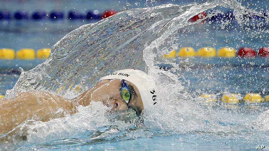 FILE - China's Sun Yang swims in his men's 200m freestyle heat at the 17th Asian Games in Incheon, South Korea, Sept. 21, 2014. Olympic and world champion swimmer Sun served a three-month ban earlier this year after testing positive for a banned stim