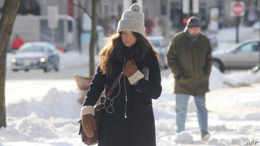 A woman walks down the street in the Back Bay a day after a winter storm in Boston, Massachusetts, Jan. 4, 2013.