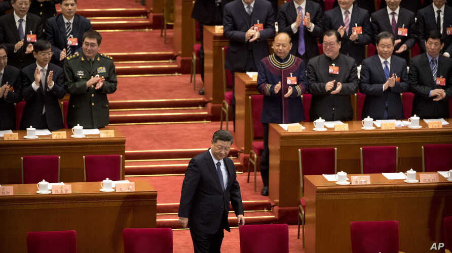 FILE - Chinese President Xi Jinping arrives for the closing session of the Chinese People's Political Consultative Conference (CPPCC) at the Great Hall of the People in Beijing, March 13, 2019.