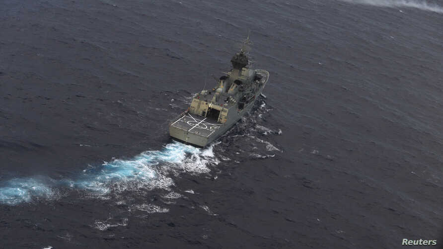 The Royal Australian Navy ship HMAS Perth is guided into position by a Royal New Zealand Airforce aircraft as the search continues for Flight MH370, April 13, 2014.
