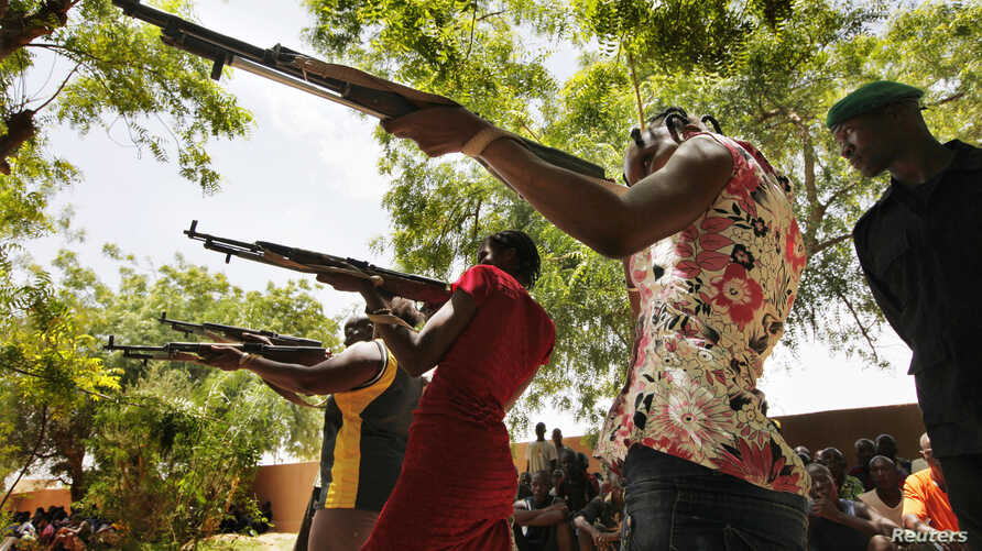 Women members of a self-defense militia calling itself the FLN [Front for the Liberation of the North] train in Sevare, about 600 kilometers northeast of the capital Bamako, Mali, July 11, 2012.