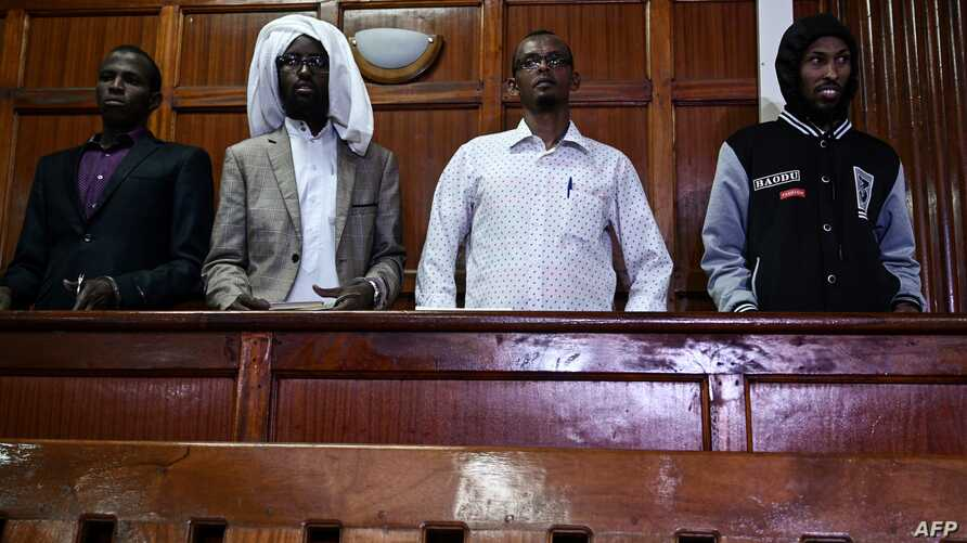 (L-R) Terror suspects Osman Abdi Dagane, Sahal Diriye, Hassan Aden Hassan and Mohamed Ali Abdikar, stand in the dock in Nairobi, Jan. 29, 2019, charged with carrying out a terrorist attack at Garissa University College four years ago.