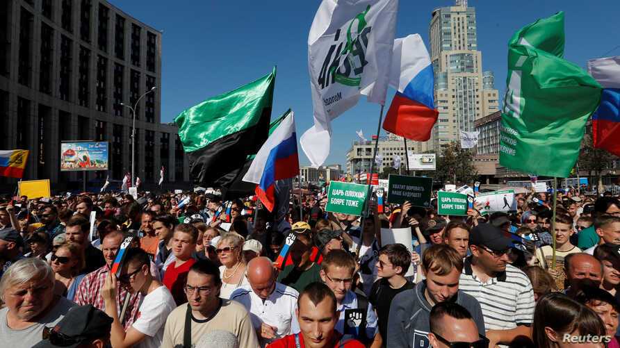 People attend a protest over the government's decision to increase the retirement age in Moscow, Russia, July 29, 2018.