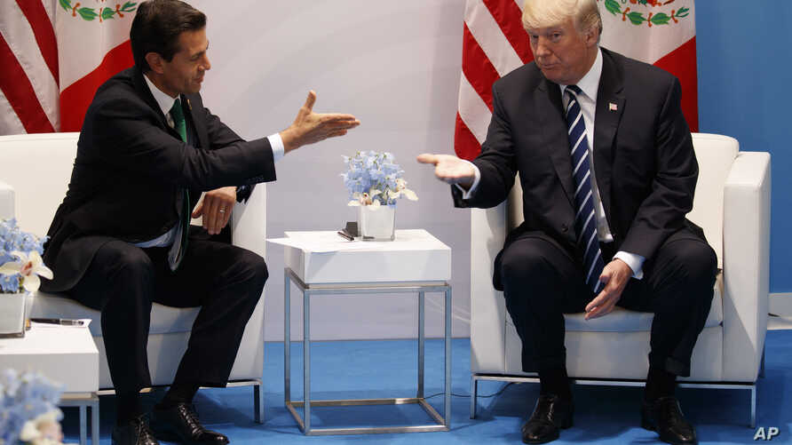 President Donald Trump meets with Mexican President Enrique Pena Nieto at the G20 Summit, July 7, 2017, in Hamburg.