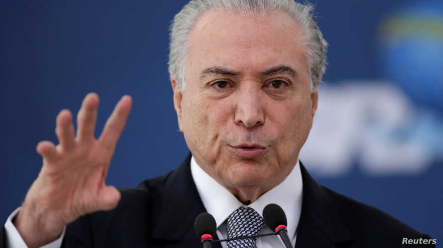 Brazil's President Michel Temer gestures during the launch of the new financing line of Bank Caixa Economica Federal Brasilia, Nov. 24, 2016. On Thursday, Dec. 1, 2016, with many governors struggling to pay pensioners and employees, Temer was forced
