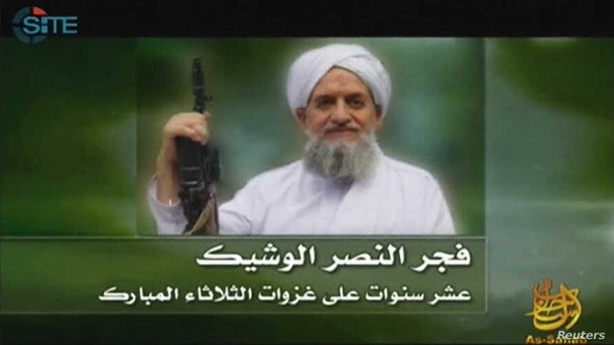 A photo of Al Qaeda's new leader, Egyptian Ayman al-Zawahiri, is seen in this still image taken from a video released on Sept.12, 2011.