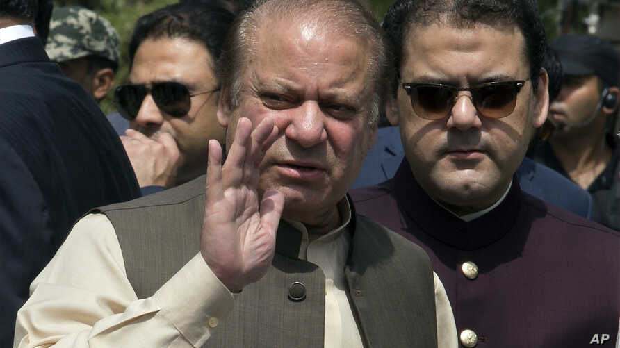 Pakistani Prime Minister Nawaz Sharif, center, with his son Hussain Nawaz, right, in Islamabad, Pakistan, June 15, 2017. Sharif appeared before a Supreme Court-appointed team investigating allegations against his family's offshore companies and money