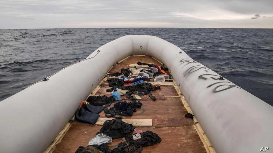 FILE - Migrants' and refugees' personal belongings lie in a rubber boat after the people were  rescued by aid workers of the Spanish NGO Proactiva Open Arms 60 miles north of Al-Khums, Libya, Feb. 18, 2018. The migrants had left Libya in an effort to