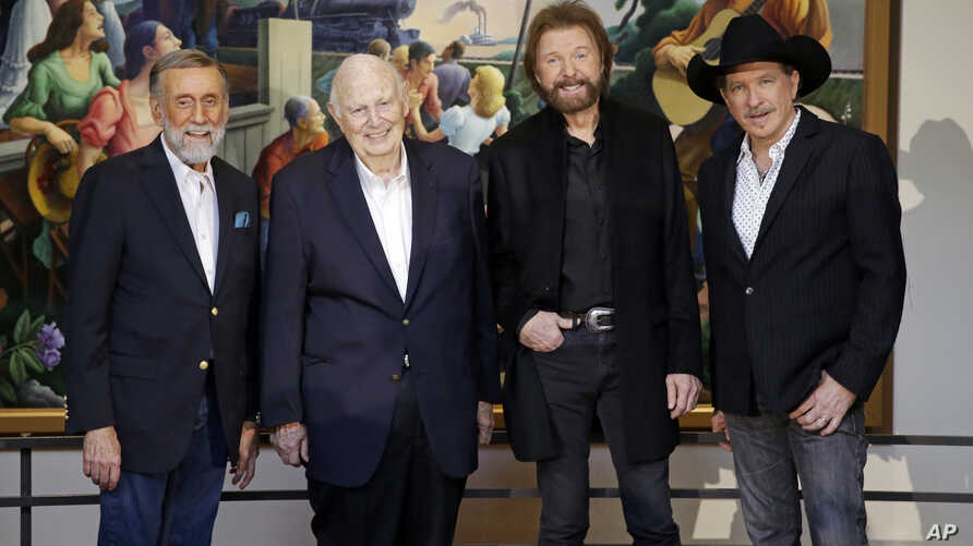 Ray Stevens, from left, Jerry Bradley, Ronnie Dunn, and Kix Brooks pose at a press conference announcing that they will be inducted into the Country Music Hall of Fame, March 18, 2019, in Nashville, Tennessee.