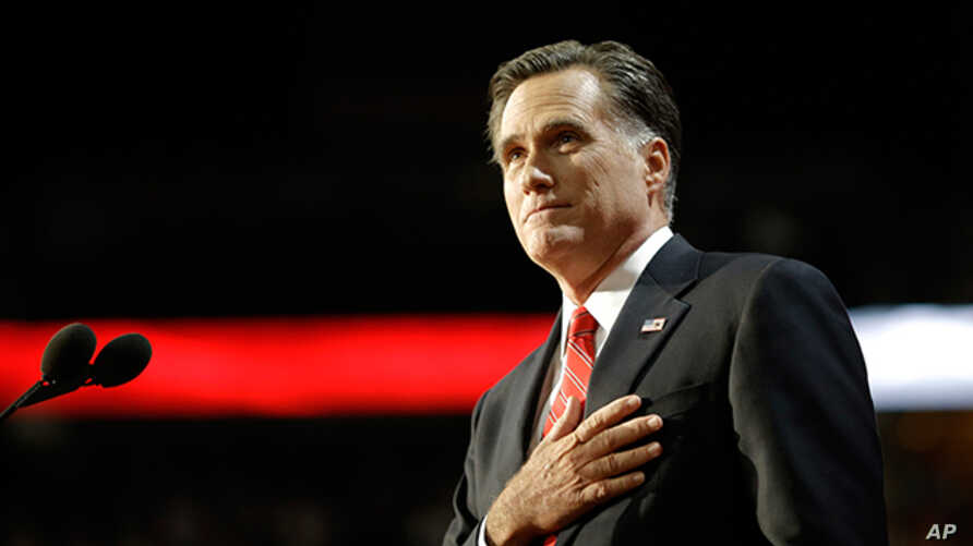 Mitt Romney acknowledges delegates before speaking at the Republican National Convention in Tampa, Florida, August 30, 2012.