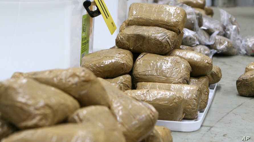 In this undated photo provided by the Australian Federal Police, packages containing methamphetamine are stacked in a warehouse in Melbourne, Australia. Australian police seized around 200 million Australian dollars ($190 million) worth of methamphet