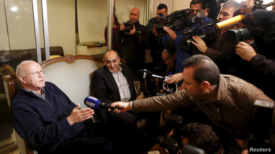 Former Lebanese information minister Michel Samaha speaks to the media at his home after being released in Beirut, Lebanon, Jan. 14, 2016.