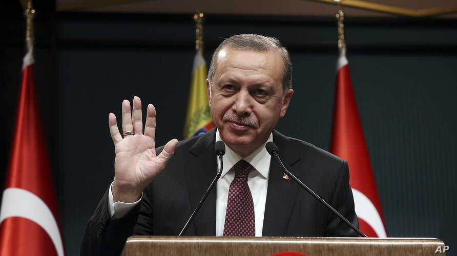 Turkey's President Recep Tayyip Erdogan gestures during a joint press conference with Venezuela's President Nicolas Maduro, following their meeting at the Presidential Palace in Ankara, Turkey, Oct. 6, 2017.