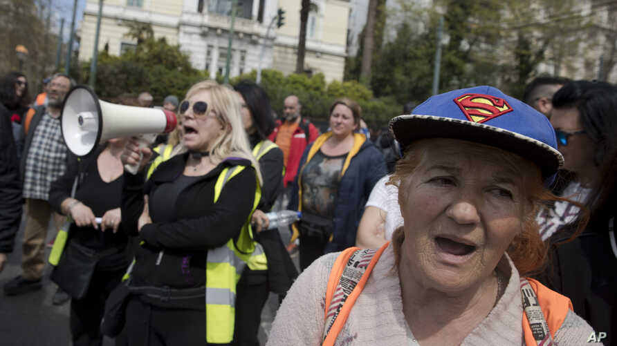 Municipal contract workers protest outside the Greek Parliament demanding their contract renewals, in Athens, March 27, 2018. Bailout creditors want Greece to continue with austerity measures after the rescue program ends in August, in exchange tor b