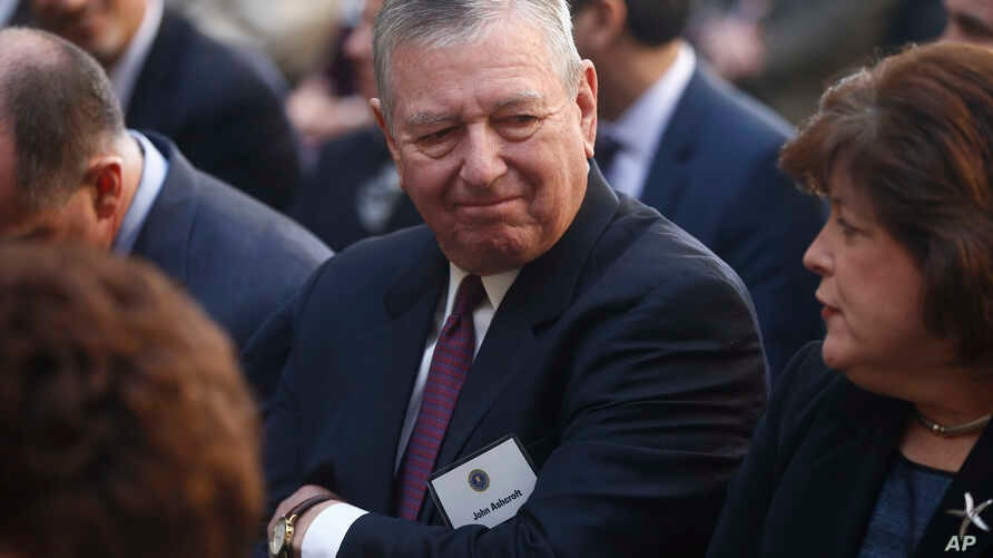 Former Bush administration Attorney General John Ashcroft is seated before President Barack Obama and FBI Director James Comey arrive at an installation ceremony at FBI Headquarters in Washington, Oct. 28, 2013.