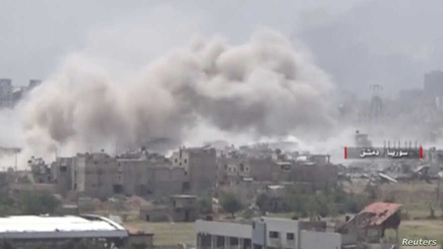 Video uploaded by the Syrian Army on May 13, 2017 shows smoke rising from Qaboun, on the edge of the capital Damascus, Syria.