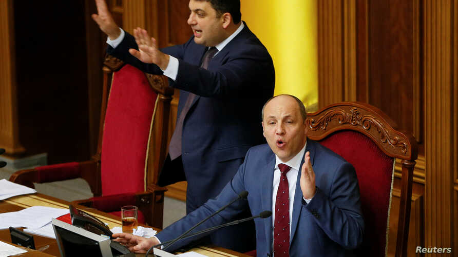 FILE - Ukrainian Parliament Speaker Andriy Parubiy (seated) and Ukrainian Prime Minister Volodymyr Groysman (L)  are see during a parliament session in Kyiv, Ukraine, Dec. 20, 2016.