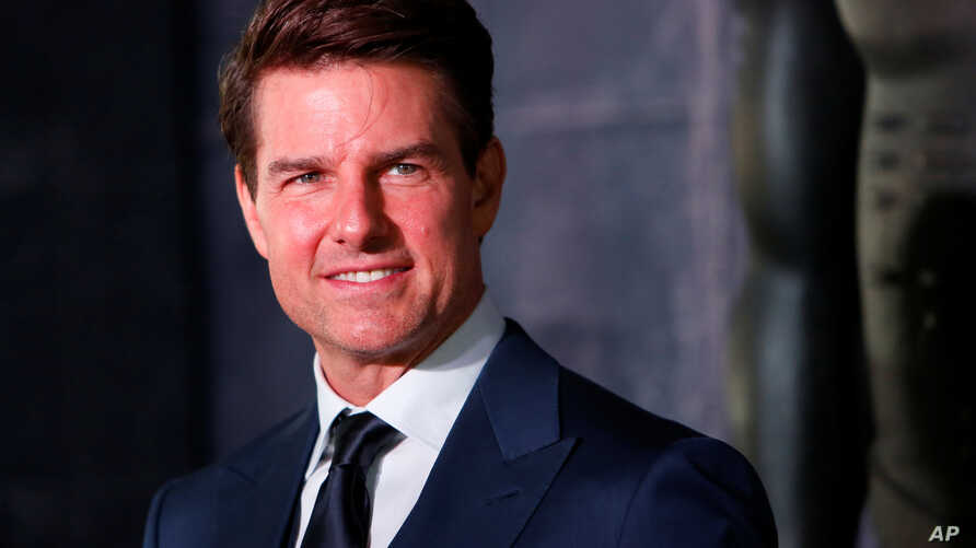 FILE - Actor Tom Cruise poses while promoting a film in Mexico City, June 5, 2017.