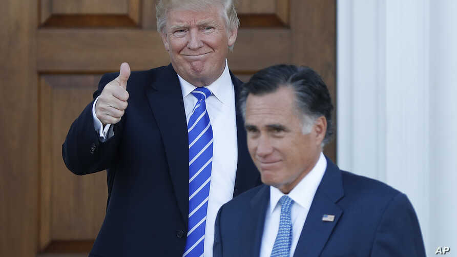 President-elect Donald Trump gives the thumbs-up as Mitt Romney leaves Trump National Golf Club Bedminster in Bedminster, N.J., Nov. 19, 2016.