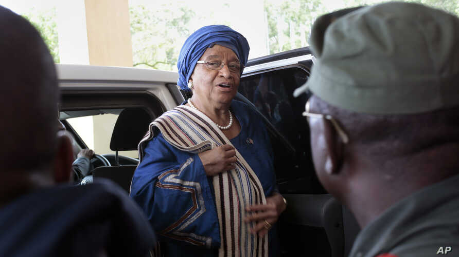 Liberia's President Ellen Johnson Sirleaf arrives at the Capitol to address lawmakers in Monrovia, Liberia, Monday Sept. 29, 2014. Six months into the world's worst-ever Ebola outbreak, and the first to happen in an unprepared West Africa, the gap be