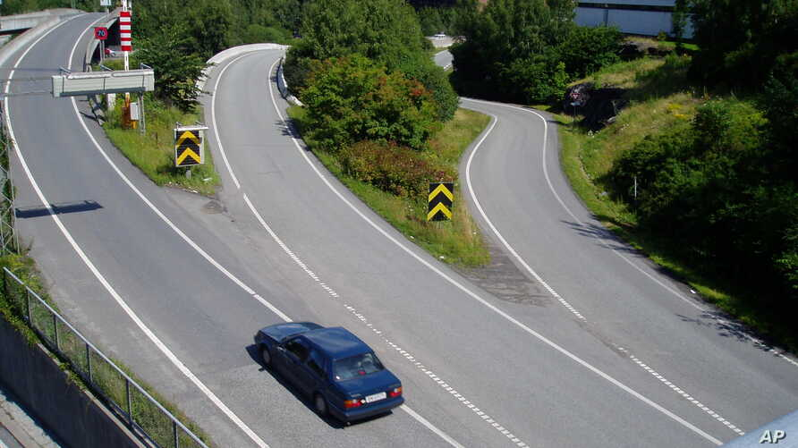A lone car has it's choice of entry ramps onto highway E-18, usually one of the busiest roads leading into the Norwegian capital, because the onset of vacation time slows Oslo to a relaxed crawl, as seen July 16, 2004.