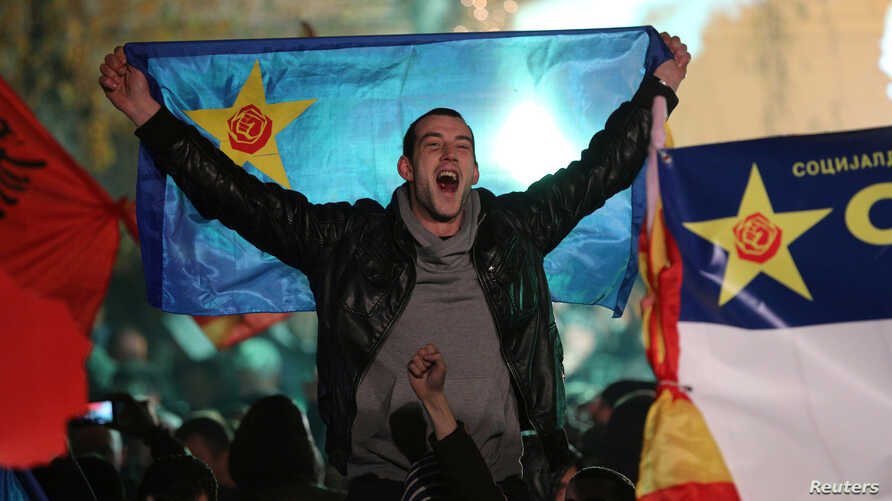 Supporters of the opposition Social Democratic Union of Macedonia (SDSM) celebrate during parliamentary elections in Skopje, Macedonia, Dec. 11, 2016.