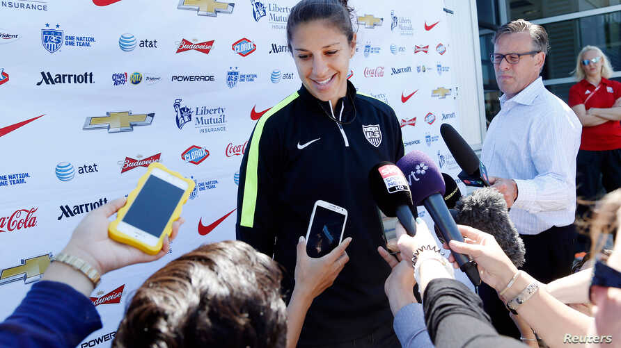 U.S. midfielder Carli Lloyd speaks to reporters before a training session for the round of eight in the FIFA 2015 women's World Cup soccer tournament at Algonquin College in Ottawa, Ontario, June 24, 2015.