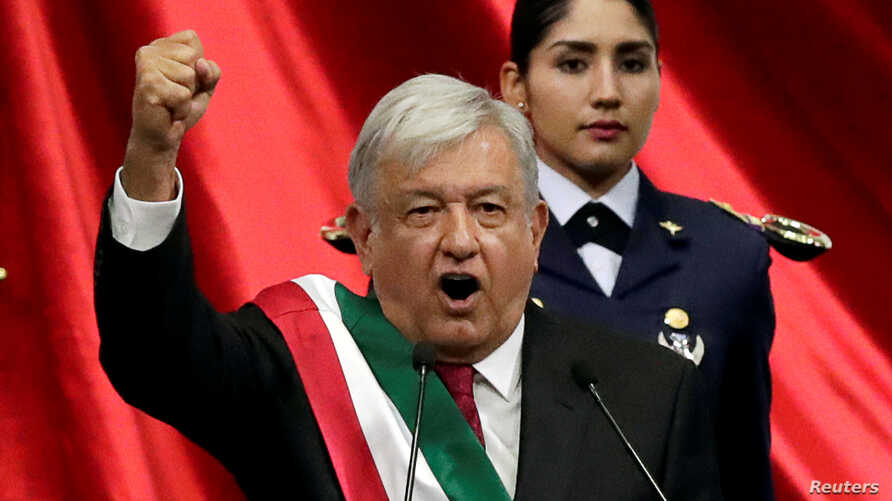 Mexico's new president, Andres Manuel Lopez Obrador, gestures during his inauguration at Congress, in Mexico City,  Dec. 1, 2018.