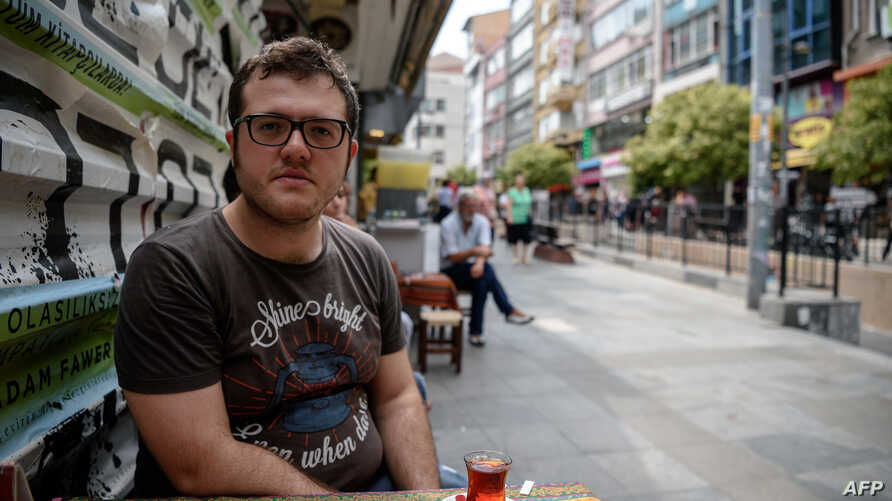 Burak Bulkan, 24, who graduated from Istanbul's Bosphorus University, poses in Istanbul, Aug. 23, 2016. Turkey canceled a major European Union-funded scholarship scheme after the July 15 botched coup bid, leaving in limbo dozens of Turkish students d