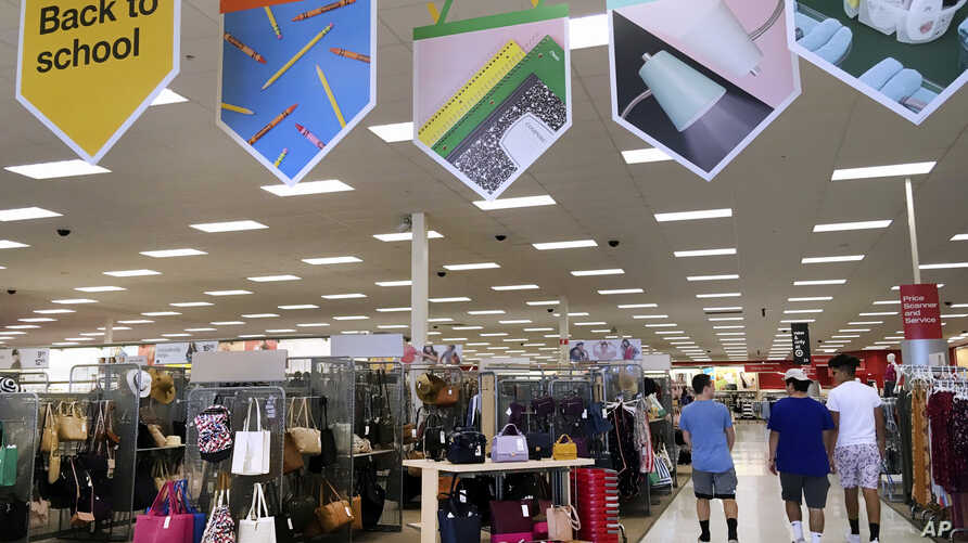 In this July 31, 2018 photo, shoppers walk into a store in Methuen, Mass.
