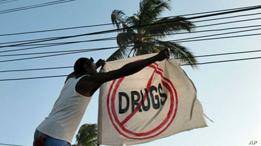 A former addict straightens a flag outside a sober house in Zanzibar, an island ravaged by heroin imported from Asia, February 9, 2012.