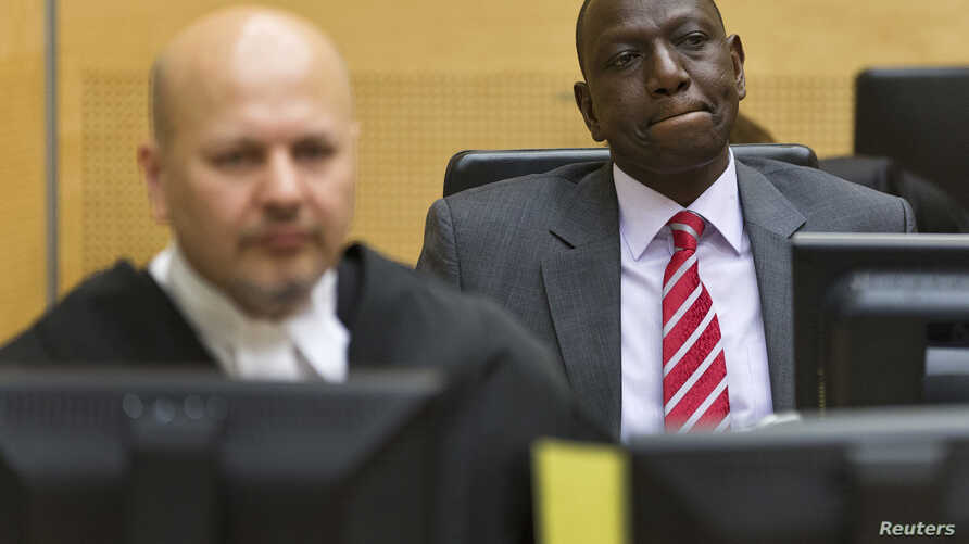 Kenya's Deputy President William Ruto (R) reacts as he sits in the courtroom before his trial at the International Criminal Court (ICC) in The Hague, September 10, 2013.