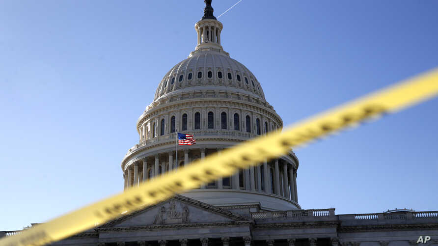 Police tape marks a secured area of the Capitol, Jan. 19, 2018, in Washington.