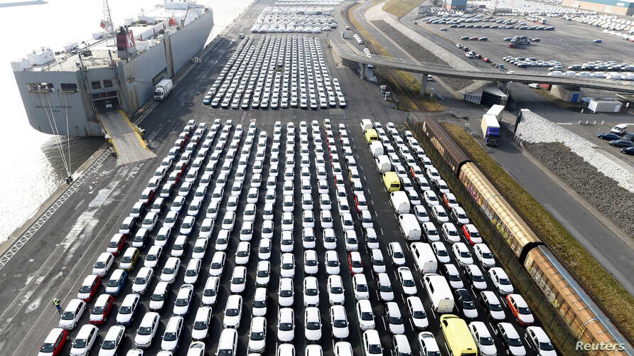 FILE - Volkswagen export cars are seen in the port of Emden, beside the VW plant, Germany, March 9, 2018.
