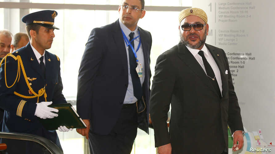 King Mohammed VI of Morocco (R) is escorted as he arrives at the 28th Ordinary Session of the Assembly of the Heads of State and the Government of the African Union in Ethiopia's capital Addis Ababa, Jan. 31, 2017.