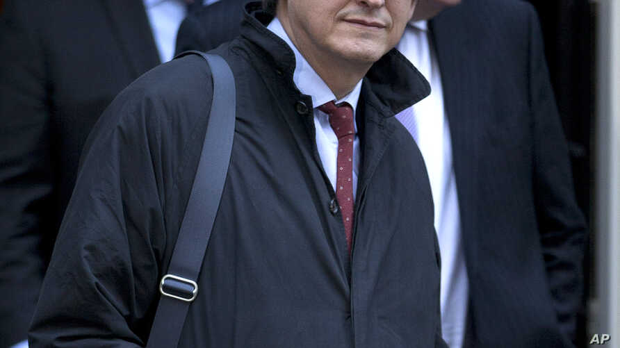 FILE - This is a Tuesday, Dec. 4, 2012 file photo of  the editor of the  Guardian newspaper Alan Rusbridger as he leaves Downing street after a meeting of fellow newspaper editors  and the British Prime Minister David Cameron following the release of